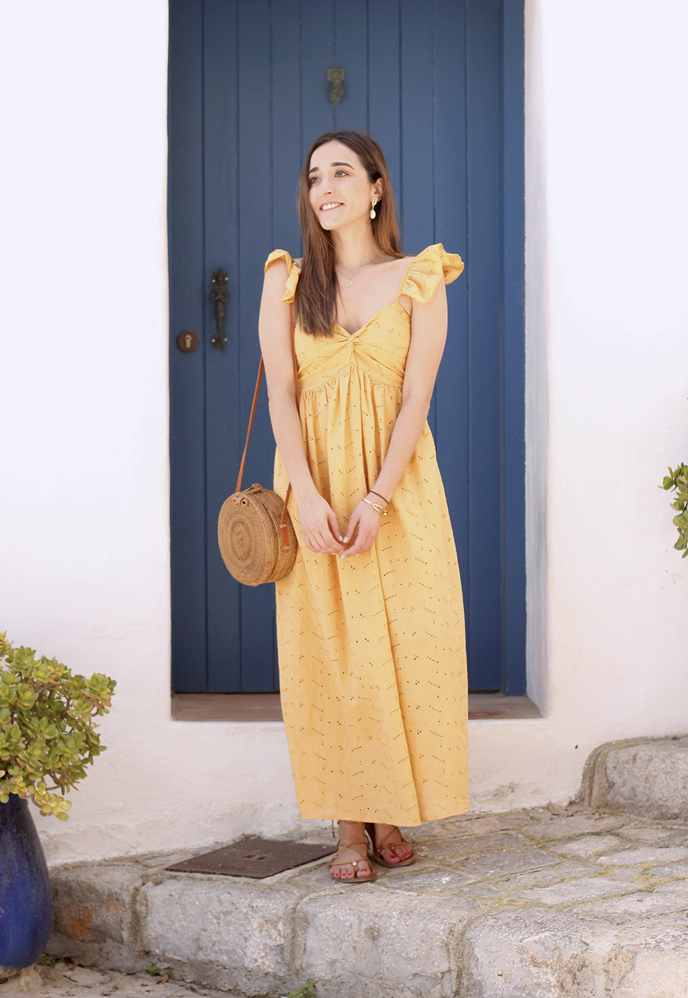 mustard embroidered midi dress straw bag street style outfit 2019 vacation ibiza11