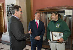 From left - State Reps. John Fusco and Craig Fishbein, talk with Josh Miller, V.P. of the New Haven Emerald Society, during the annual New Haven Pizza Lobby Day at the Capitol.