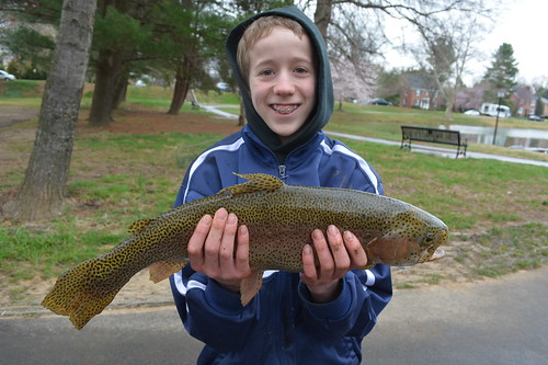 Photo of boy holding trout