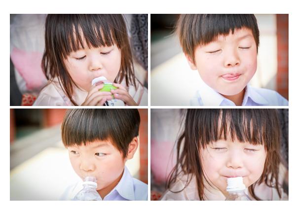 お茶を飲む子供の顔のアップ