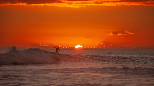 surfing surfer waves sunset water sky clouds sport horizon silhouette