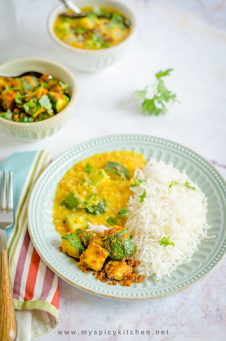 Plate of besan zucchini stir fry with rice and dal