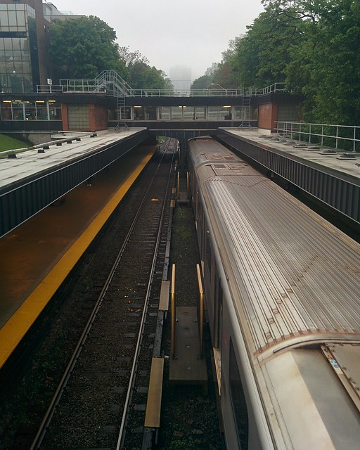 Looking north at the northbound train at Rosedale #toronto #rosedale #ttc #subway #train #green #yellow #grey #sky #rain