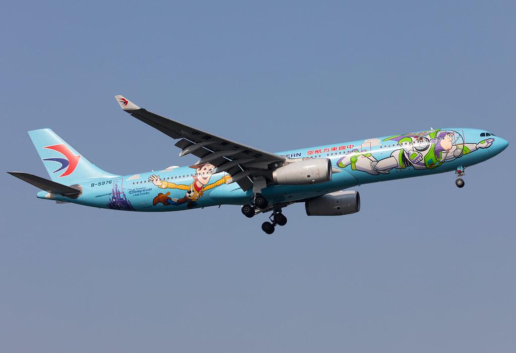 "The light blue ""Disneyland Shanhai"" logojet on short final for RWY18L completing another shuttle flight from Beijing PEK. Delivered 06/2015."