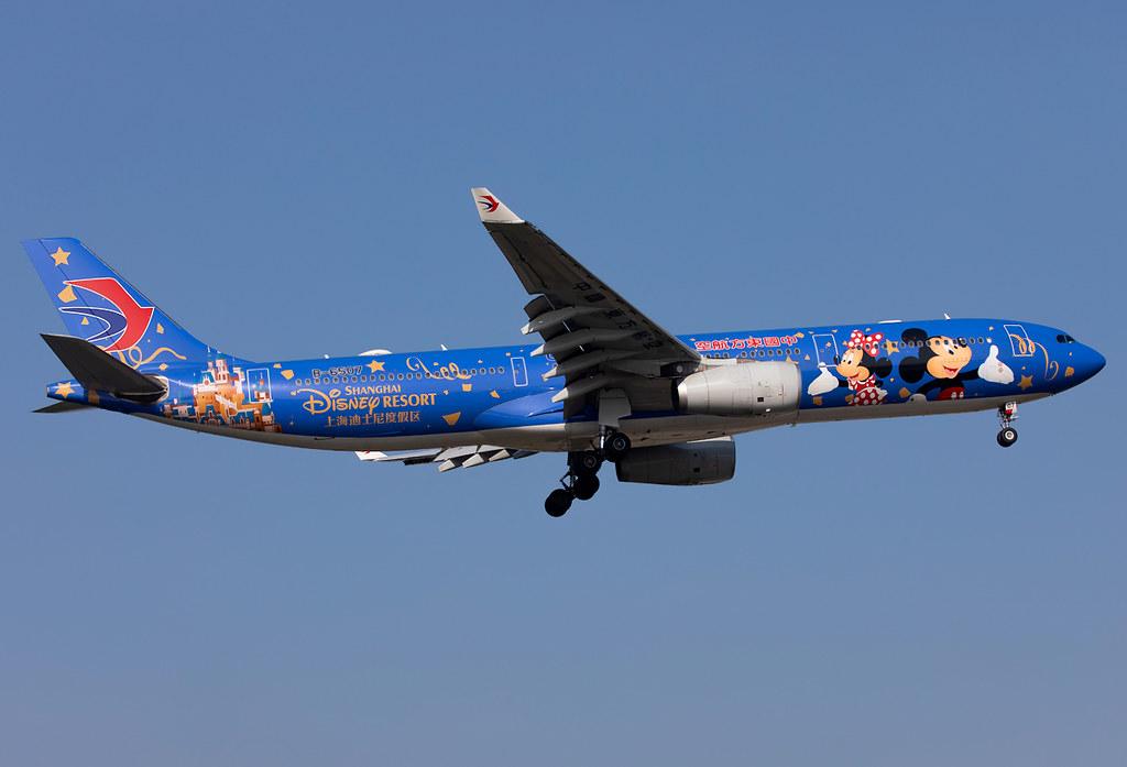 "The dark blue ""Disney Land Shanghai"" logojet on short final for RWY18L completing a flight from Tokyo HND. Delivered 08/2008."