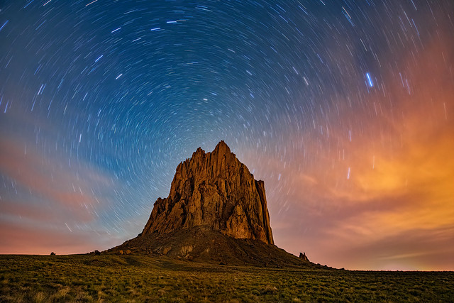 Star trails over Shiprock volcanic rock formation on Navajo land near Shiprock, New Mexico
