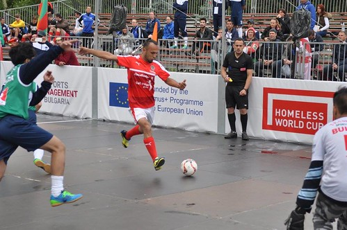 A player kicking a ball during one of the homeless world cup football games