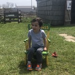 Ezra sits on the Potty Toss seat
