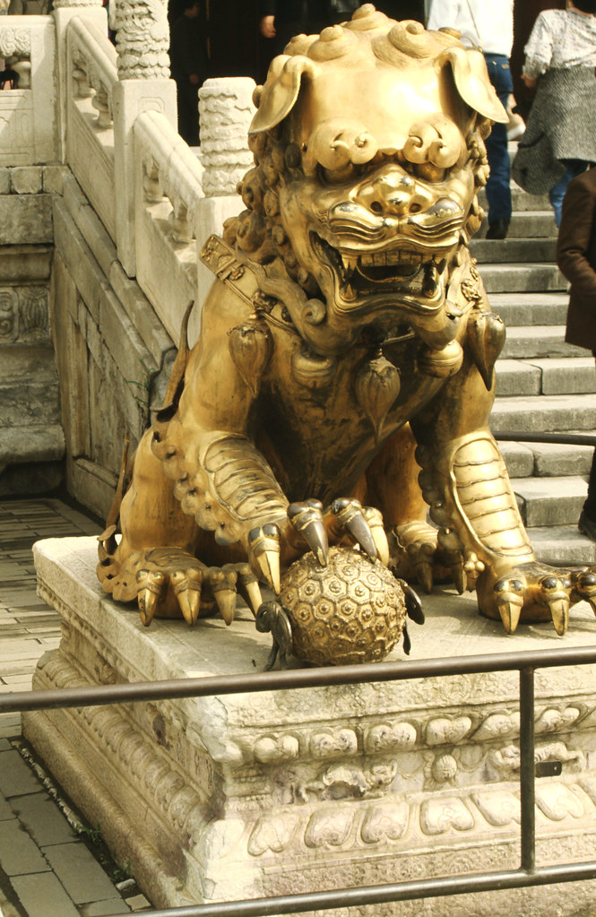 Statue of a lion guarding a gateway in the Forbidden City, Beijing