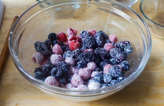 toss berries with flour