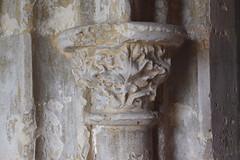 north doorway detail: oak leaves