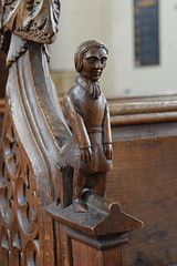 bench end: man standing in front of a square stool (19th Century)