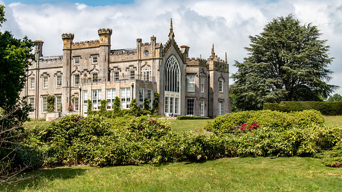 sheffieldpark house mansion building gradei listed gothic garden seat rhododendron shrubbery hedge tree park grass sky landscape sussex