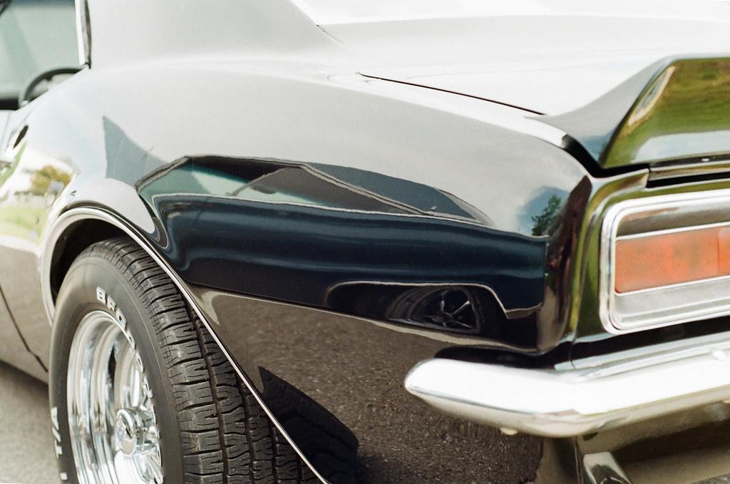 Satellite reflected in the Camaro