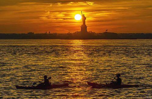 sunset statueofliberty uppernewyorkbay canoe canoeing