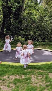 Flower girls having no fun in silk Fairytale dresses!