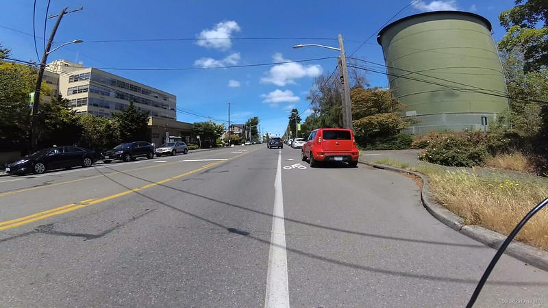 Even a small red car parked is a little into the bike lane.