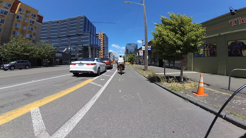 A wide one way bike lane with paint buffer.