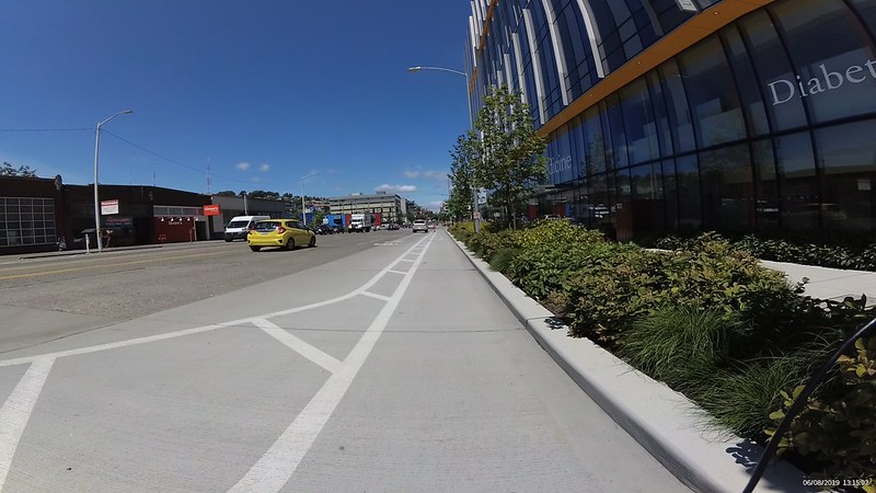 The wide lane narrows via paint into a 3-4 foot wide bike lane.