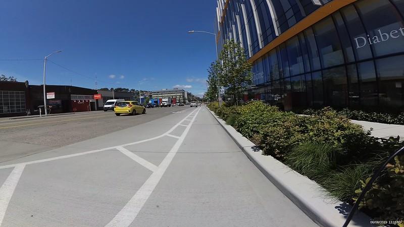 The wide lane narrows via paint into a 3-4 foot wide bike lane.