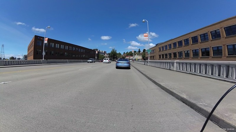 An open nearly unpainted expanse of pavement with no visible bike markings.