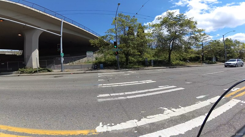 A curb cut onto a sidewalk at I-90 and Rainier