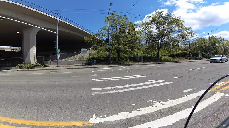 A curb cut onto a sidewalk at I-90 and Rainier