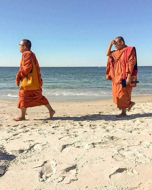 View from our beach chairs: Buddhist monks passing by #goodkarma #ipswich #mmphoto
