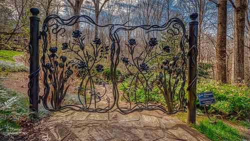 gibbsgardens ballground ga usa unitedstates gate pathway trees forest northgeorgia mountains botanical park garden ironwork landscape sculpture artwork ericstrauss