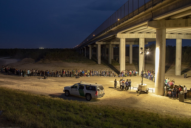 Migrants Surrender to U.S. Border Patrol