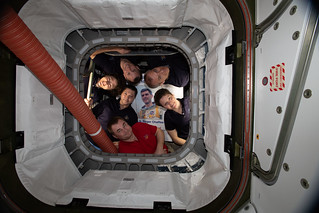 The Expedition 59 crew inside the Cygnus space freighter | by NASA Johnson