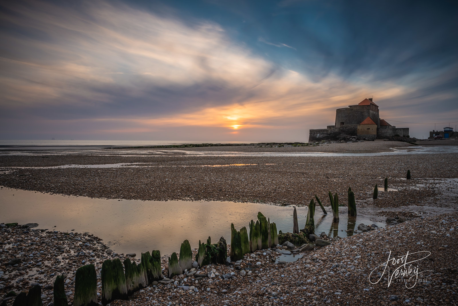 Fort Mahon in Ambleteuse during sunset at low tide