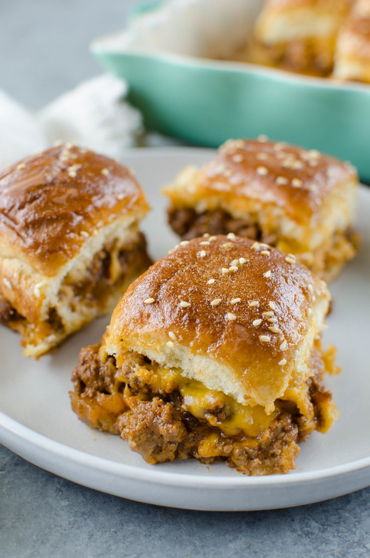 Sloppy Joe Sliders - an easy way to serve sloppy joes to a crowd! Sloppy joe meat and cheese on Hawaiian rolls and covered in the most delicious glaze. Great for a weeknight dinner, a party, or tailgating!