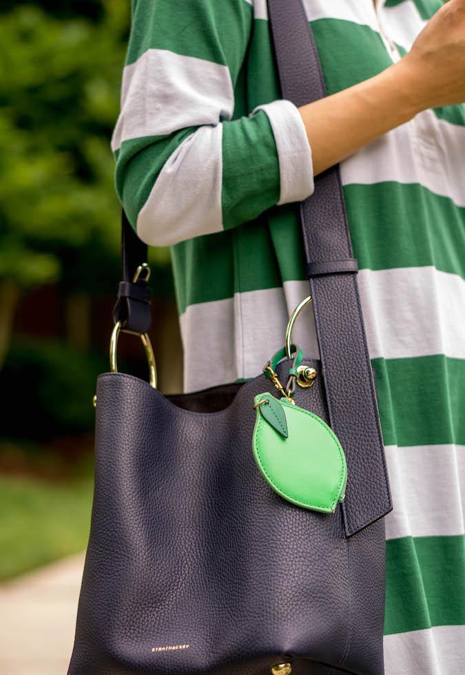 J.Crew 1984 rugby shirtdress, Strathberry Lana midi bucket bag, J.Crew lime coin purse as bag charm