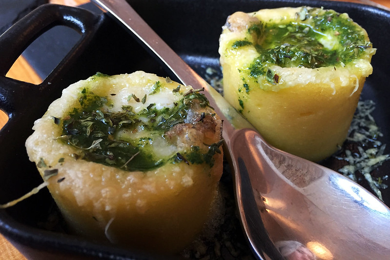 Polenta rounds stuffed with four types of cheese and topped with pesto