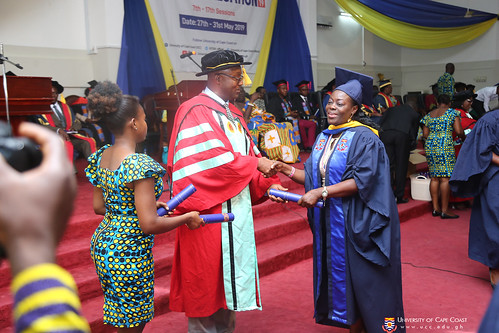 Graduands receiving their scrolls