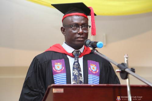 Mr. Ebenezer Dzinpa Effisah, Assistant Registrar, mentioning the names of first class graduands