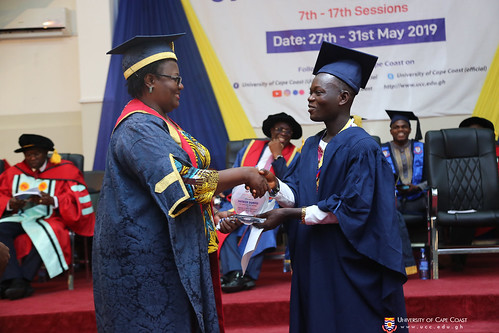 A graduand being presented with an award.