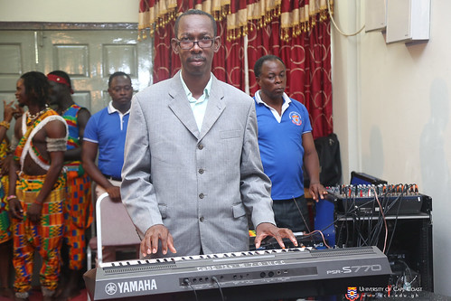 Mr. Benedict Assan Sackey, Deputy Director of Music, playing the organ.