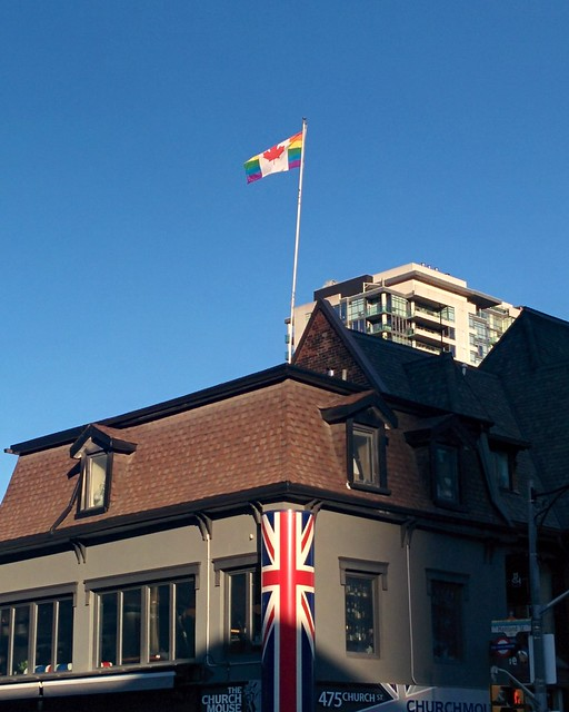 Rainbow flag waving high #toronto #churchandwellesley #churchstreet #maitlandstreet #rainbow #flag #canada #lgbtq