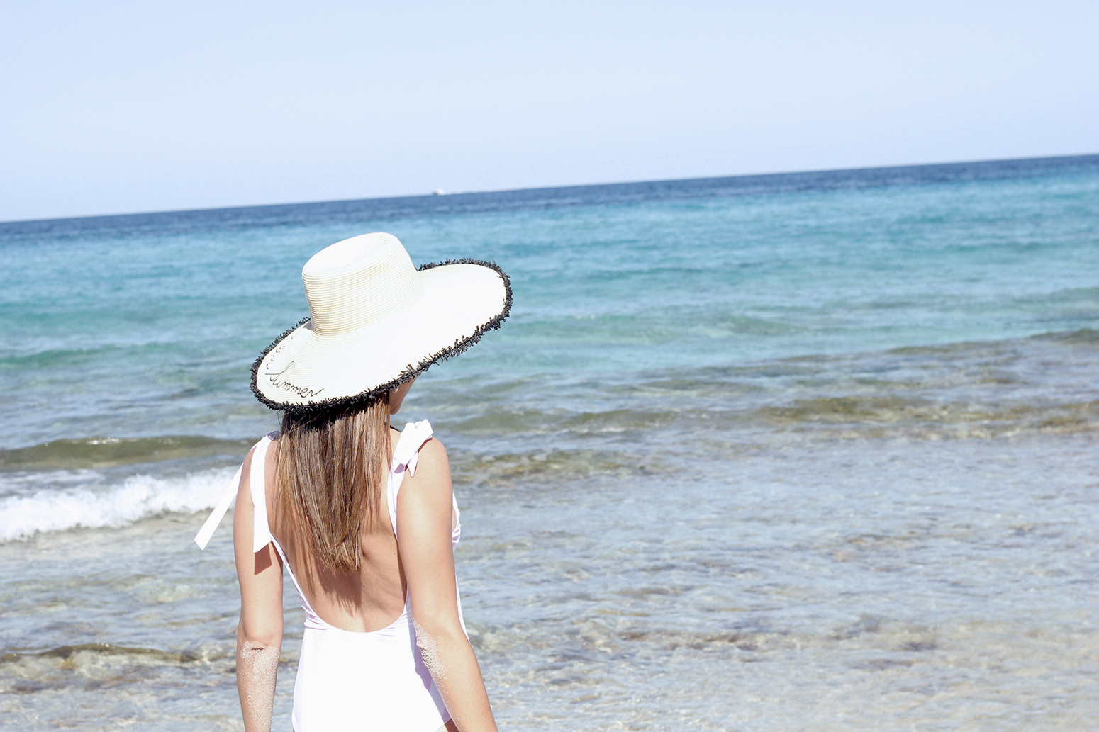 white embroidered dress straw hat striped swimsuit beach formentera street style outfit 201918