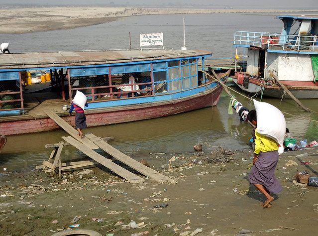 Loading rice at the Mingun Jetty on the Irrawaddy River in Mandalay, Myanmar