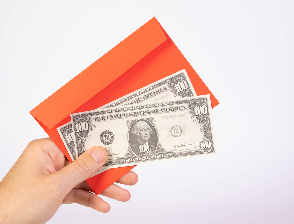 Hand Holding Red Envelope And Money Marco Verch Is A Pro