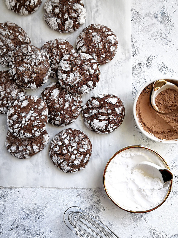 chocolate brownie crinkle cookie with powdered sugar and olive oil