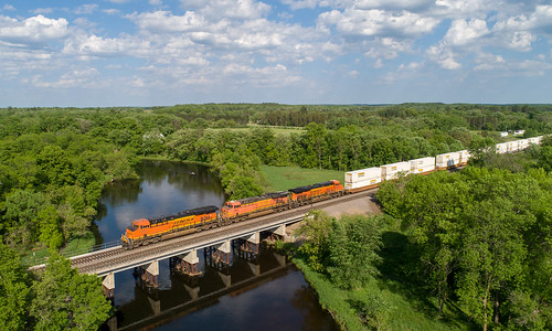 train railroad locomotive stacktrain bnsf bnsf7963 burlington bnsfrailway burlingtonnorthernsantaferailway river dronephotography aerialphotography dji djiphantom4prov20 staplessubdivision philbrookmn gees44c4 es44c4