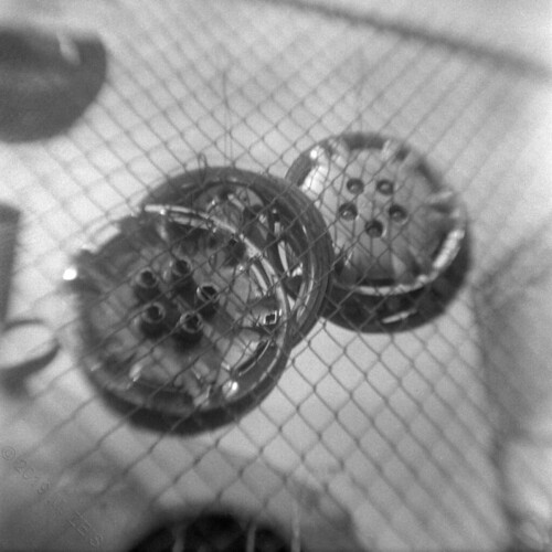hubcaps on a fence153