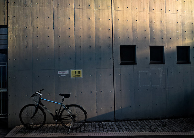 Wall, shadows and bicycle