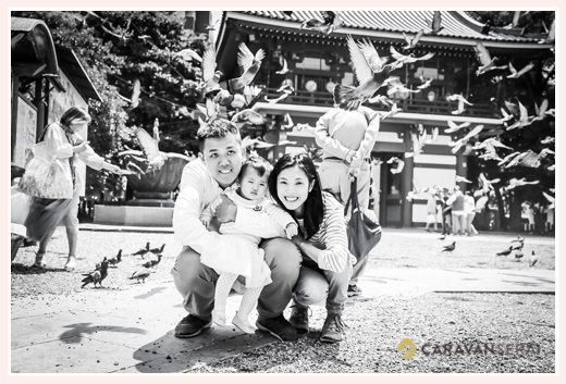 A family from Hong Kong with pigeons, Osu Kannon temple, Nagoya, Japan