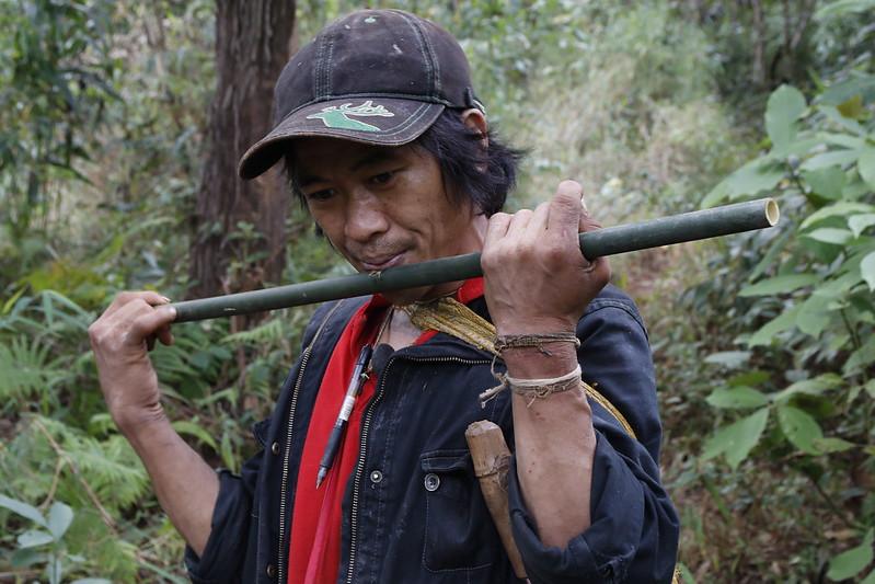 Jakar playing a bamboo flute.