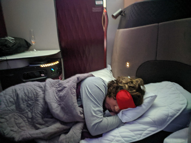 sleeping comfortably on a plane